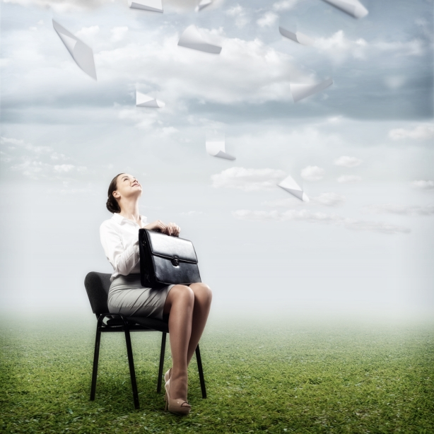image of a business woman looking at the falling paper